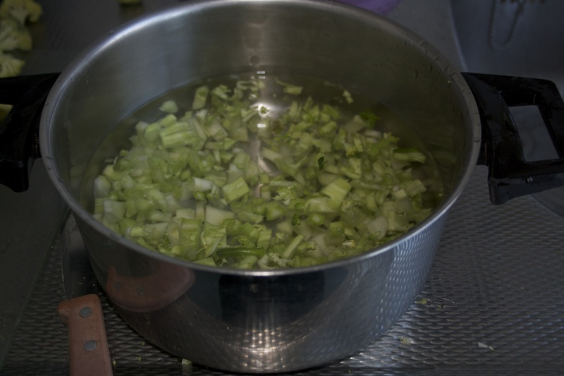 Fill a pan with the butchered broccoli stems and plenty of water