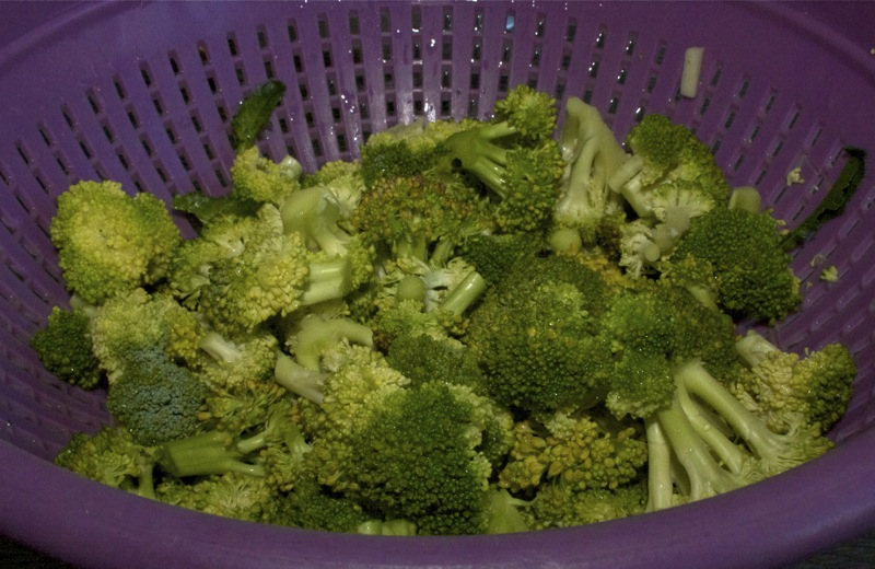 Give the broccoli heads a good wash with boiling hot water